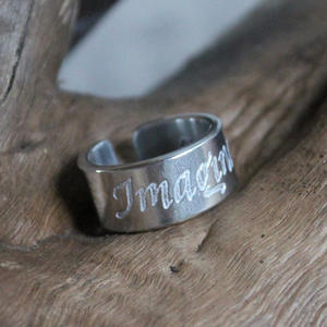 "Ring med text ""Imagine"""